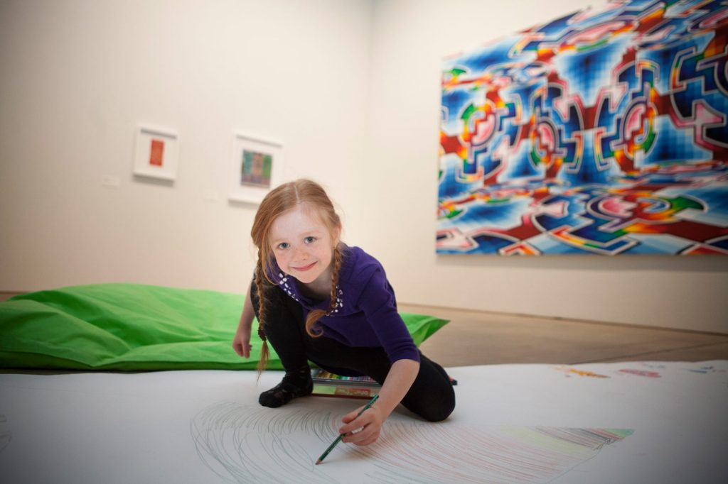 An excited young participant at a Slow Art Day 2016 event in Helsinki, Finland.